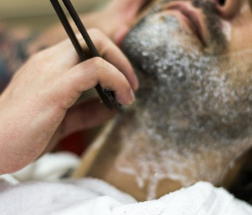 man getting neck shaved